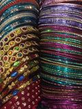 Bangles assorted colours. Assorted colourful bangles worn on the wrist suitable for day and evening wear. Exquisite, decorative, stylish, fashionable, affordable Stock Image