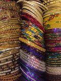 Bangles Galore. Assorted colourful bangles worn on the wrist suitable for day and evening wear. Exquisite, decorative, stylish, fashionable, affordable bright Royalty Free Stock Image