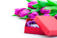 Bangles in the gift box and tulips Royalty Free Stock Photo