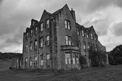 Abandoned industrial buildings from a deserted village and asylum. This is bangour village hospital and asylum which was abandoned more than two decades ago. It royalty free stock photos