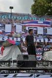 Banguecoque/Tailândia - 08 05 2013: O bloco amarelo das camisas e ocupa Lumphini Fotos de Stock