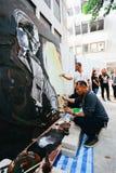 BANGUECOQUE, TAILÂNDIA - 22 DE OUTUBRO DE 2016: Povos tailandeses que pintam o portr foto de stock royalty free