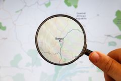 Bangui, Central African Republic. Political map. City visualization illustrative concept on display screen through magnifying glass in the hand stock image
