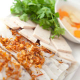 Banh cuon. Vietnamese steamed rice paper with pork, beef and chicken insied with fresh fried onions tofu,  and meat ham -  patev, egetables and coriander Royalty Free Stock Photo