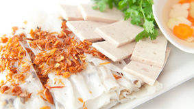 Banh cuon. Vietnamese steamed rice paper with pork, beef and chicken insied with fresh fried onions tofu,  and meat ham -  patev, egetables and coriander Royalty Free Stock Images