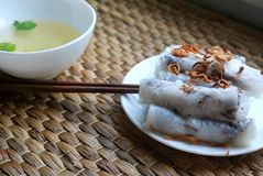 Banh cuon-vietnamese steamed rice rolls with minced meat inside accompanied by bowl of fish sauce. Banh cuon-vietnamese steamed rice rolls stuffed with minced Royalty Free Stock Images