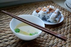 Banh cuon-vietnamese steamed rice rolls with minced meat inside accompanied by bowl of fish sauce. Banh cuon-vietnamese steamed rice rolls stuffed with minced Stock Photos
