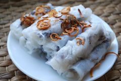 Banh cuon-vietnamese steamed rice rolls with minced meat inside accompanied by bowl of fish sauce. Banh cuon-vietnamese steamed rice rolls stuffed with minced Stock Photography