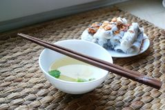 Banh cuon-vietnamese steamed rice rolls with minced meat inside accompanied by bowl of fish sauce. Banh cuon-vietnamese steamed rice rolls stuffed with minced Royalty Free Stock Photography