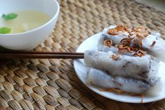 Banh cuon-vietnamese steamed rice rolls with minced meat inside accompanied by bowl of fish sauce. Banh cuon-vietnamese steamed rice rolls stuffed with minced Royalty Free Stock Image