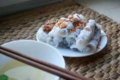 Banh cuon-vietnamese steamed rice rolls with minced meat inside accompanied by bowl of fish sauce. Banh cuon-vietnamese steamed rice rolls stuffed with minced Royalty Free Stock Photo