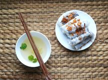 Banh cuon-vietnamese steamed rice rolls with minced meat inside accompanied by bowl of fish sauce. Banh cuon-vietnamese steamed rice rolls stuffed with minced Stock Photo