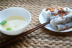 Banh cuon-vietnamese steamed rice rolls with minced meat inside accompanied by bowl of fish sauce. Banh cuon-vietnamese steamed rice rolls stuffed with minced Stock Images