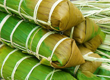Banh tet, Vietnam glutinous rice cake. Banh tet for Lunar New Year, Vietnam Tet, food make from glutinous rice, meat, green bean, cover by banana leaf, tie by Stock Image