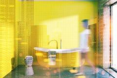 Banheiro amarelo com um chiar tonificado Imagens de Stock Royalty Free