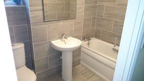 Banheiro pequeno do granito Fotografia de Stock Royalty Free