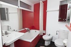 Banheiro vermelho Imagens de Stock