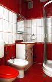 Banheiro vermelho Fotos de Stock Royalty Free