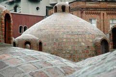Banhos do enxofre de Tbilisi na área de Abanotubani, Geórgia Fotos de Stock Royalty Free