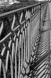 Banister in B&W. A view of an old banister in black and white Royalty Free Stock Photo