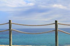 Banister railing on marine rope and wood Royalty Free Stock Photo