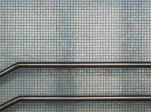 Banisters. Railing against pearl tiles in station Vathorst, Amersfoort Stock Photography