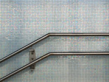 Banisters. Railing against pearl tiles in station Vathorst, Amersfoort Stock Photos
