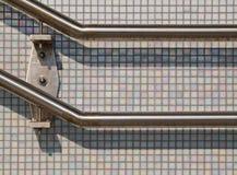 Banisters. Railing against pearl tiles in station Vathorst, Amersfoort Stock Photo