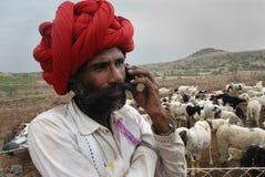 Banjara Tribes in India. December 11,2010 Mandu,Madhya Pradesh,India-A Banjara man talking through the mobile phone. They are the typical nomads who wonder from royalty free stock photos