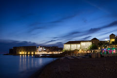 Banje beach and Old Town in Dubrovnik at dusk Royalty Free Stock Photos