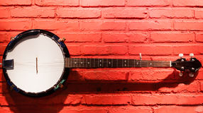 Banjo hanging on the wall Stock Photos