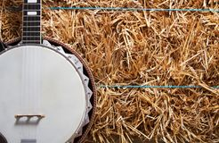 Banjo on a hay stack royalty free stock images