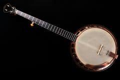 Banjo metálico en fondo negro Fotos de archivo