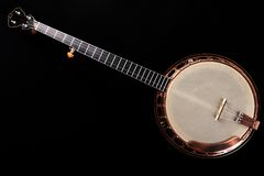 Banjo metalic on black background Stock Photos