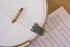 Banjo over muziek Stock Afbeelding