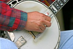 Banjo picking. Closeup of mans hands picking the banjo royalty free stock photography