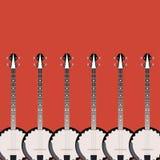 Banjo piega dello strumento della corda su un fondo colorato Fotografia Stock