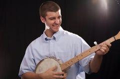 Banjo Player. Young man having a good time playing the banjo Royalty Free Stock Photo