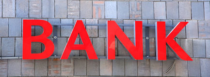 Bank. Sign on wall background Royalty Free Stock Photography
