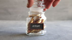 Bank Account Banking Financial Savings idea. Glass jar with gold coins. stock footage