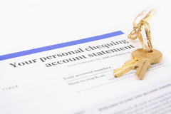 Bank account statement and golden key Royalty Free Stock Photo
