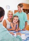 Bank agent consulting family with kids Stock Photography
