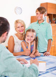 Bank agent consulting family with kids Stock Photo