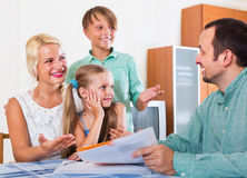 Bank agent consulting family with kids Royalty Free Stock Photography