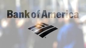 Bank of America logo on a glass against blurred crowd on the steet. Editorial 3D rendering Royalty Free Stock Photo