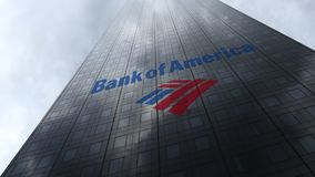 Bank of America logo on a skyscraper facade reflecting clouds. Editorial 3D rendering Royalty Free Stock Images