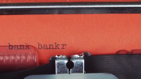 Bank bankrupt - Typed on a old vintage typewriter. Printed on red paper. The red paper is inserted into the typewriter.  stock footage