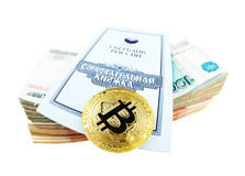 Bank book of Sberbank, stack of rubles and bitcoin coin Royalty Free Stock Image