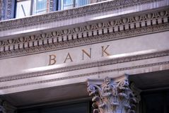 Bank building. Old building with letters bank on it Stock Image