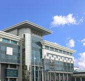 Bank building. Photo of a modern building of large bank on a background of the cloudless sky Royalty Free Stock Photos